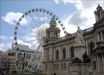 A 60-metre high Ferris stands close to Belfast's City Hall in Northern Ireland.