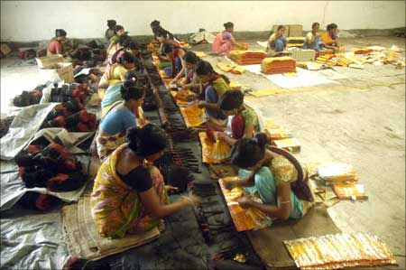 Women make incense sticks in a factory on the outskirts of Agartala.