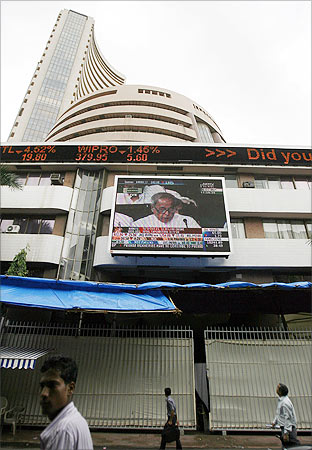 Finance Minister Pranab Mukherjee presents the annual budget on a large display screen on the facade of the Bombay Stock Exchange.