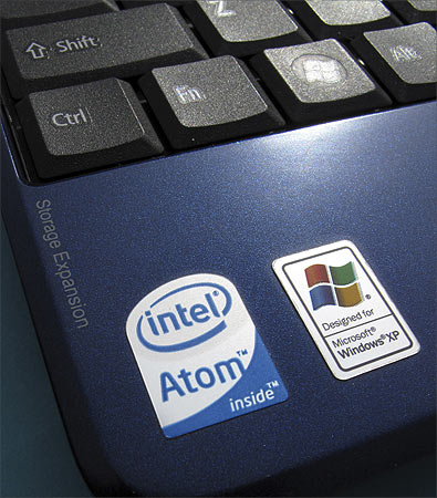 An Intel Inside sticker is shown next to a Windows XP sticker on an Acer Netbook.