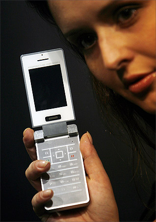 A model displays P'9521, the first Porsche Design mobile phone, during its India launch.