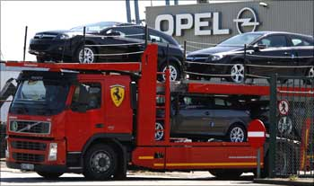 A truck loaded with cars leaves the Opel assembly plant in Antwerp, Belgium.