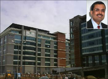 MphasiS office in Bangalore. (Inset) MphasiS CEO Ganesh Ayyar.