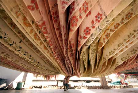 A worker dries saris at a factory in Hyderabad.